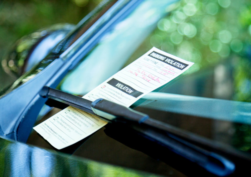 Ticket fine on a windshield card.